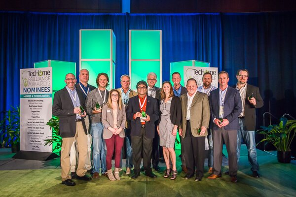 Equator president Atul Vir receives a Brilliance Award at the 2016 TecHome Builder Summit.