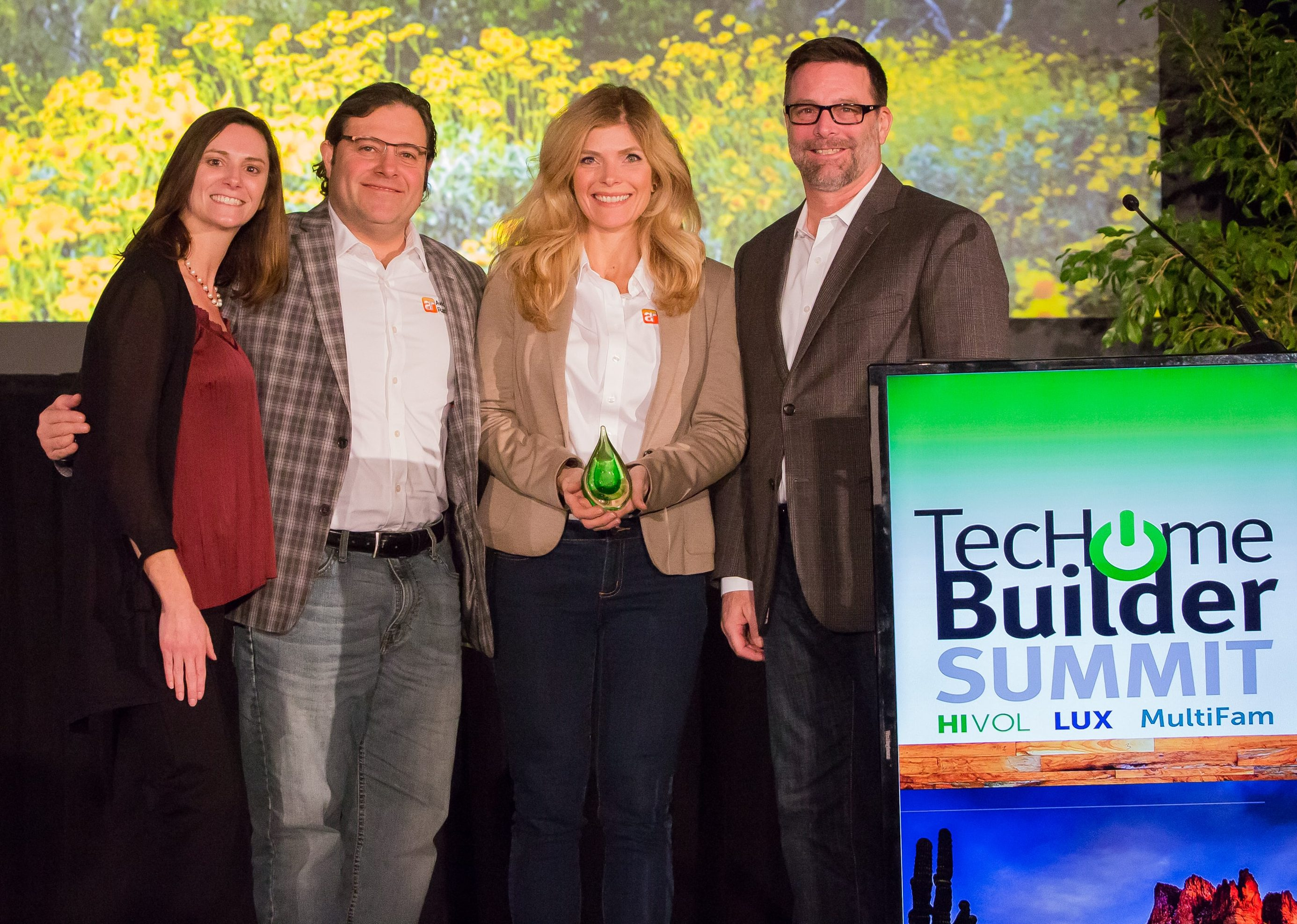 Avid Ratings' Paul Cardis (second from left), Jessica Leising and Tom Kuhne accept the TecHome Brilliance Award for Avid's GoTour.