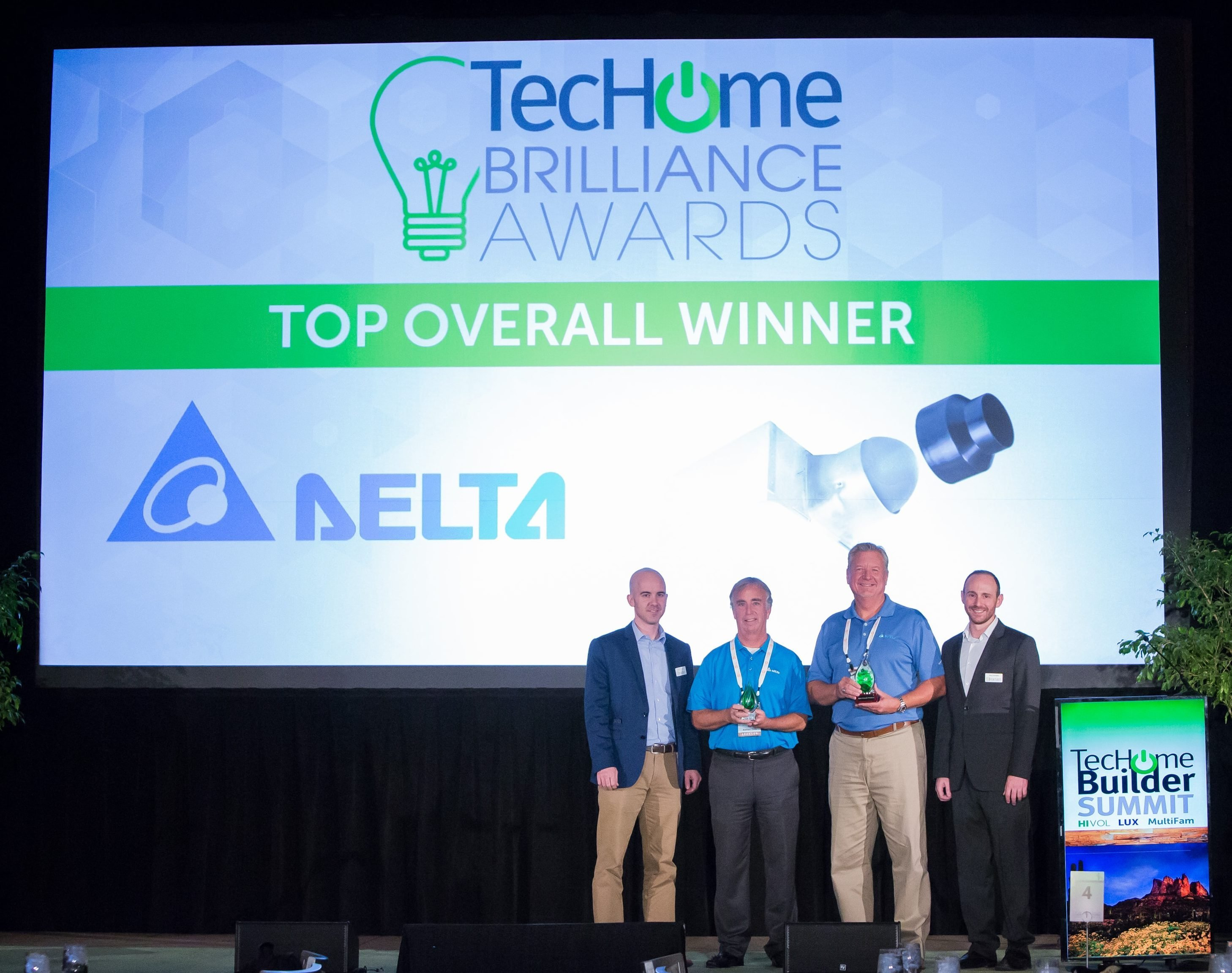Delta's John McGonagle and Boyd Sheets (second from right) accept their TecHome Brilliance Awards.