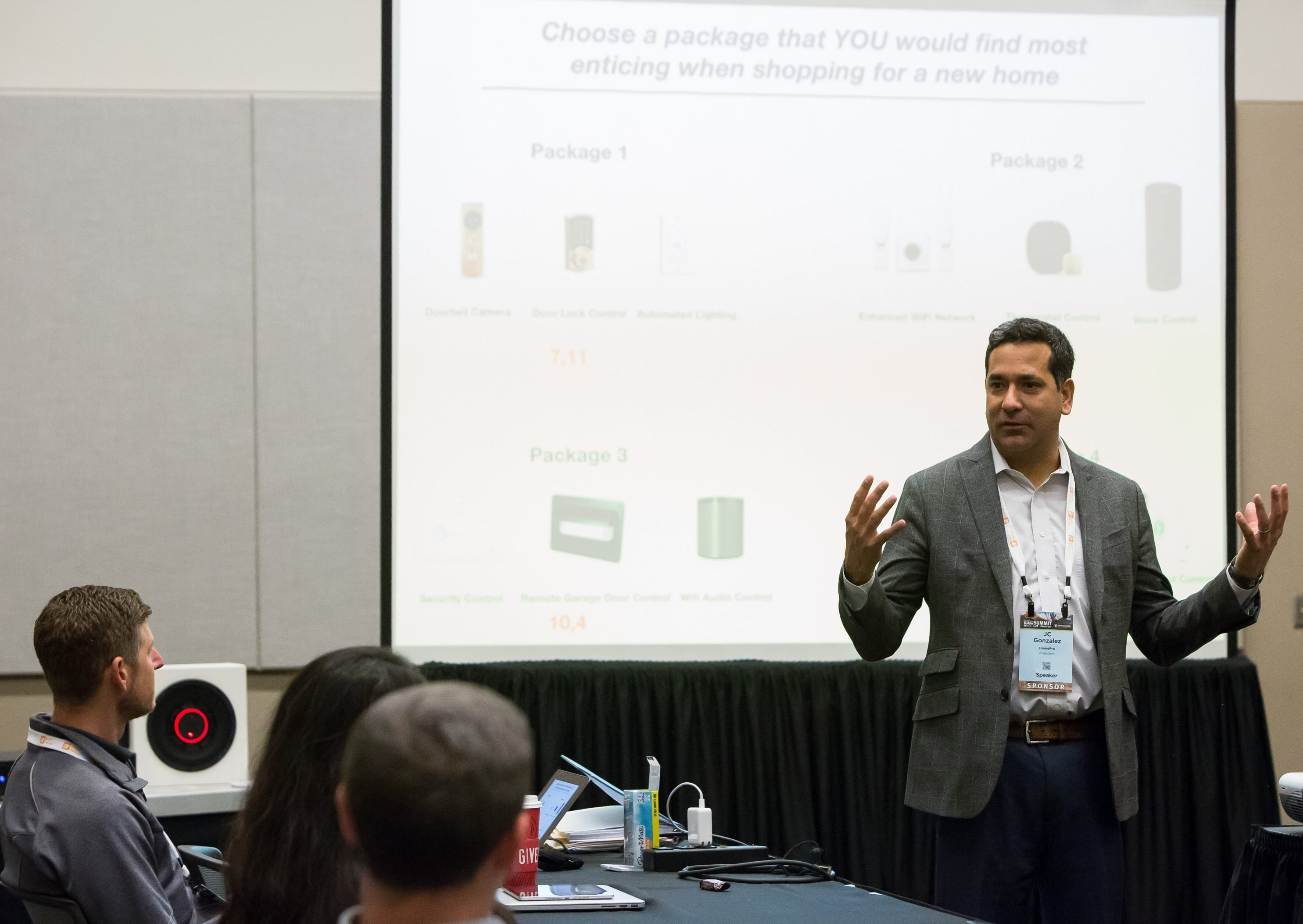 Gonzalez discusses the importance of offering tech packages during a boardroom meeting at the TecHome Builder Summit.