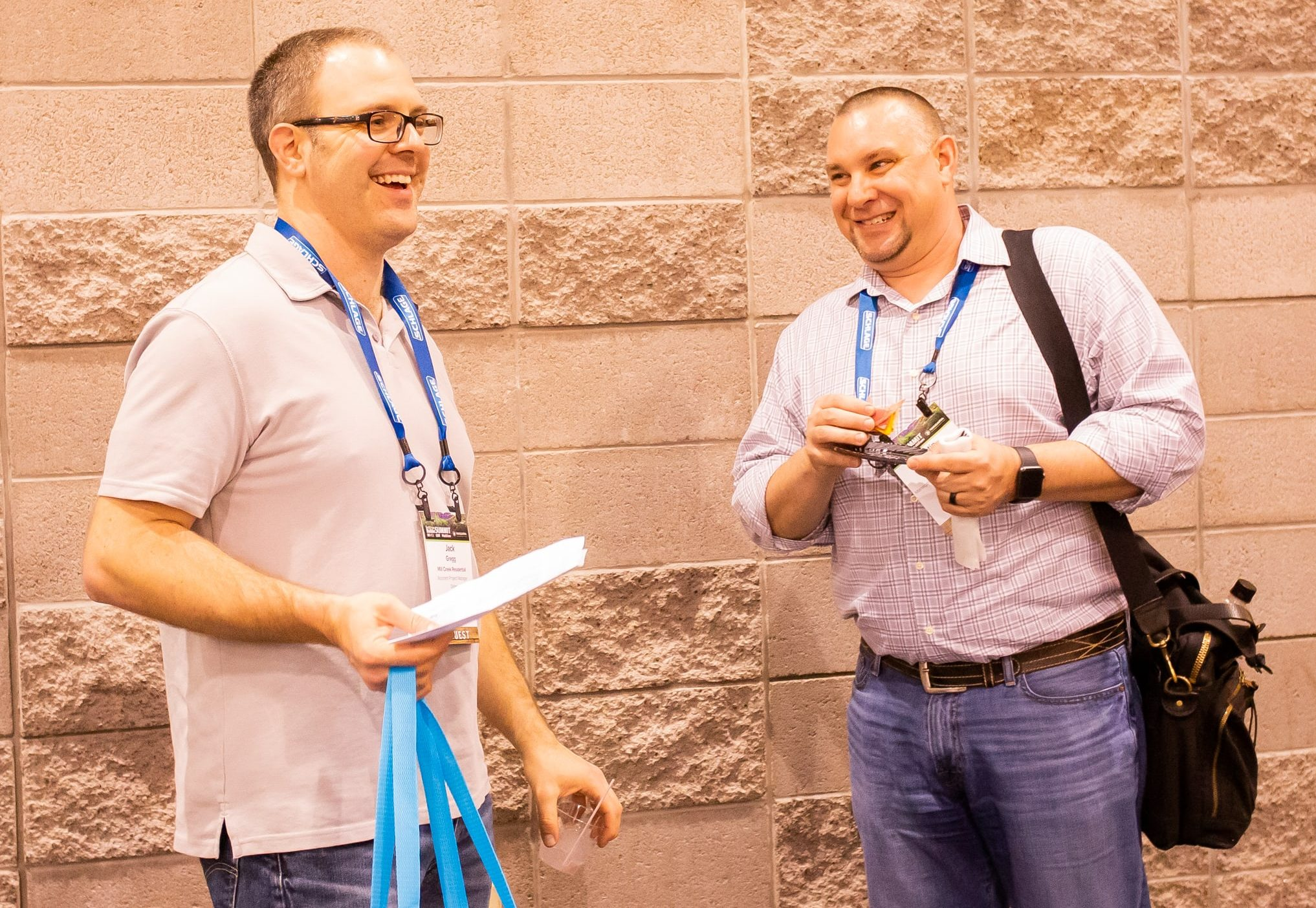 Foster (right) catches up with Mill Creek Residential assistant project manager Jack Gregg during the 2018 TecHome Builder Summit.